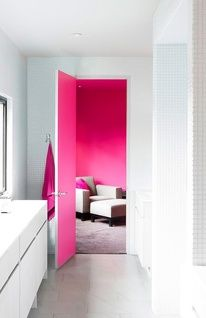 the pink door makes a stand out with the white, and the black and white adds a pop of colour in a statement, simple room
