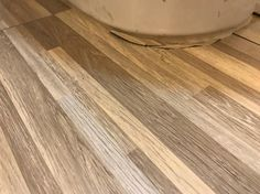 flooring prep adhered unheated remains firmly kitchen install all tile cottages this real vinyl wold free articles floor design trafficmaster wood id in renovation estate about year cottage winnipeg
