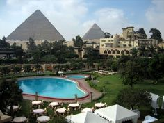 Mena House Oberoi, Cairo - stayed here in 1983 -had breakfast our first morning in the restaurant with the pyramids outside the window.  Surreal!