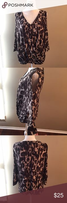 SMYS leopard cold shoulder top SMYS leopard cold shoulder top. Very flattering draping in front. Polyester spandex blend. Top runs very small please see size chart. SMYS Tops