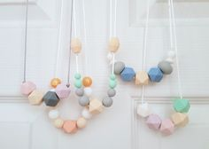 Teething Necklaces / Nursing Necklaces for Mom & Baby. Made of silicone (the same material as teethers). Chew - safe , easy to clean , the perfect baby shower gift idea for new moms.