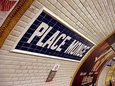 """Metro de Paris - Ligne 7 - Place Monge 02.jpg  """"The station is located under Place Monge, in the 5th arrondissement, in the eastern part of the Latin Quarter. Nearby are the Jardin des Plantes (botanical garden), the Roman remains of the Arènes de Lutèce and the Rue Mouffetard, a street with restaurants and a lively street market."""" (End of CW12)"""