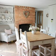 country cottage dining room. dining room with fireplace. home decor and interior decorating ideas.