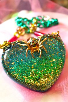 Itsy Bitsy Spider Necklace  Glitter Resin by athinalabella on Etsy, $85.00  https://www.etsy.com/au/listing/82601292/itsy-bitsy-spider-necklace-glitter-resin?ref=shop_home_active_15   I love it!!