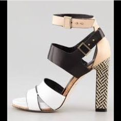 """Rachel Roy Rachel Roy Fawn Ankle Strap Sandals A bold contrast heel provides an unexpectedly neural focal point for colorblock high-heel sandals. Antiqued buckles and buttons secure the double ankle straps, and cutout straps cross at the vamp. Leather sole. Heel: 4.5"""". Rachel Roy Shoes Heels"""
