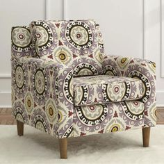 In love with the chair and suzani print!