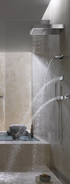 This shower looks heavenly with the rain shower head, water fall faucet, and 2 additional faucets!