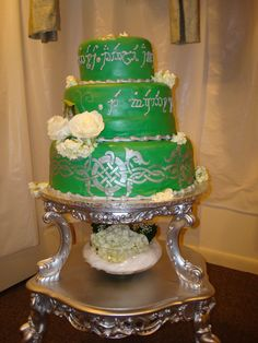 LOTR Orthodox Wedding Cake - This is a green wedding cake with the Eastern Orthodox wedding song written in Elvish because the bride & groom are Lord of the Rings fans