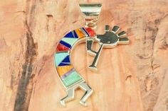Navajo Jewelry Genuine Turquoise, Blue Lapis, Sugilite and Spiny Oyster Shell inlaid between ribbons of Sterling Silver. Kokopelli Sterling Silver Pendant Designed by Navajo Artist Calvin Begay. www.treasuresofth...