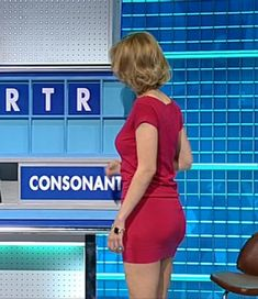 Rachel Riley ; snug-fitting raspberry dress on UK TV's version of 'Letters & Numbers', 'Countdown'.
