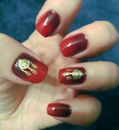 Red ombre nails with gold dreamcather stamps