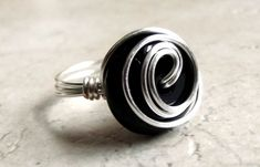 Black Onyx Statement Ring SherryKayDesigns Enter shop here: http://www.etsy.com/shop/SherryKayDesigns This handcrafted, statement ring is made from a 16mm shiny and smooth black onyx rondelle stone, which has been securely wire wrapped with 20 gauge fine silver plated artistic