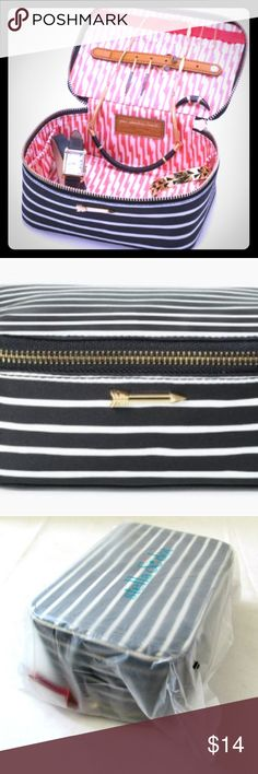 Stella & Dot Striped Jewelry Makeup Case Stella & DotTravel Jewelry BoxBlack Cream Stripe Organizer - New With Tags Could easily be used as a makeup case!   This is a 100% Genuine Stella & Dot Product! Product will come in original packaging.  Exterior: Woven wipeable fabricHardware: Shiny gold signature Stella & Dot arrow detail hardware.Interior: Coral and white ikat  Jewelry not included.  : ) Stella & Dot Bags Travel Bags