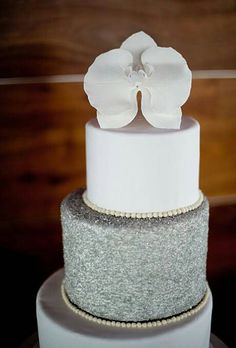 059858d436a67ae8d457222bf425eb79 white and silver wedding cake with orchids on fancy birthday cakes in atlanta