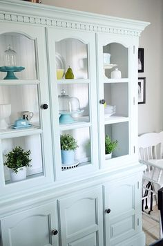 I want a cabinet like this for all my nice glasses, vintage silverware and hopefully some china (one day!)  Paint colors: Gray: Notre Dame by Valspar and Aqua: Aqua smoke by Behr