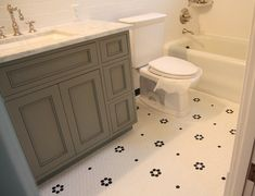 urban grace interiors | hex tile with pattern | marble countertops | gray cabinets <HC>