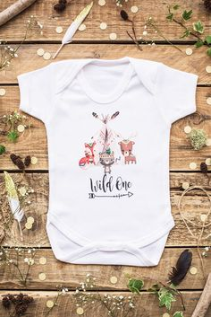 Awesome first birthday design for your little Wild One or perhaps as a gift! Here We have the words Wild One,with a row of little tribal animals all lined up ready for the party! Priding ourselves on The highest workmanship and an amazing quality of clothing, you will be amazed how