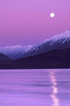 Purple Sunset  All of my favorite things combined. Purple, moon, mountains and water. <3