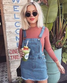 Pink top with cute blue denim overalls.