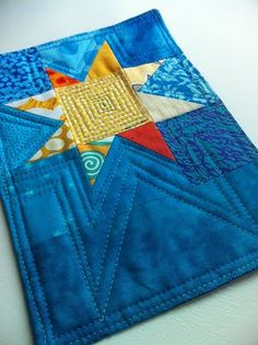 Mug rug - love the star shaped quilting