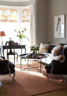 Taupe, charcoal and orange... quiet calm and elegant.  LOVE ...apart from the carpet...could do without that. Orange. Photo: Anne Nybleaus/Sköna hem