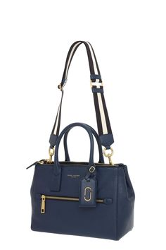 """The Marc Jacobs Gotham East-West Leather Tote Bag is an absolute necessity with gorgeous leather, gilded accents and an all-new logo detail.   - Rolled top handles, 5"""" drop - Removable, adjustable web shoulder strap, 20"""" drop - Hanging logo tag; logo embossing at top center - Open top - Snap gusset sides - Exterior front zip pocket - Front and back zip compartments - Inside, faic lining; two open pockets - Metal feet protect bottom of bag - 9.7""""H x 13""""W x 6""""D - Materials: 100% Leather"""