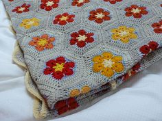 Flower crochet Afghan. Love the little tiny stripe of bright blue around each flower. It adds just a tiny bit of brightness!