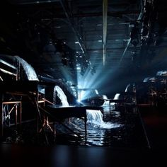 Waterfalls flow over catwalk  at Hunter fashion show