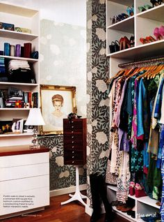 i adore this closet. the portrait, jewelry stand, and wallpaper scream chic
