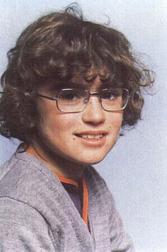 George Michael, wearing glasses in a school picture