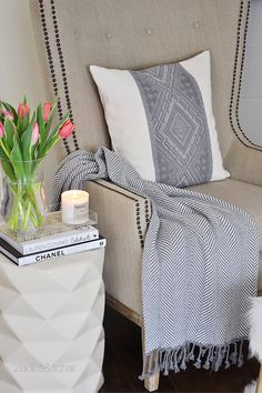 I love the light cotton fabric in this throw from HomeGoods. A special touch is the knotted fringe. In keeping with my simple theme, the pillow is grey and white. The books topped with this small tray from HomeGoods make the perfect spot to add a pop of pink with fresh flowers and a scented candle. Sponsored by HomeGoods