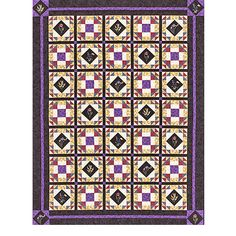 Geometric Quilting Project-A fussy-cut floral print fills block centers in this elegant quilt design