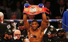 April 10 2016 - Anthony Joshua stops Charles Martin in two rounds at London's O2 Arena to claim the IBF heavyweight title