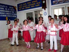 Romanian children dancing in traditional dress