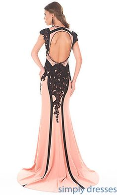 Floor length dress with cap sleeves and open back.