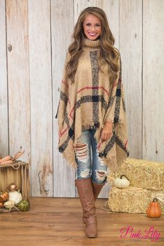 You're going to stay classy all season long in this gorgeous plaid poncho! Featuring a classic combination of dark tan, red, and black plaid, it's a knockout look!