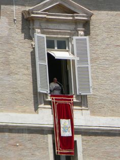 Catching a glimpse of Pope Francis at St. Peter's Square, Vatican City.