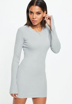 Gray dress featuring ribbed fabric, long sleeves, crew neck and bodycon design.