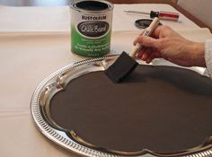 Paint a vintage silver tray from the dollar store with chalkboard paint. Then…
