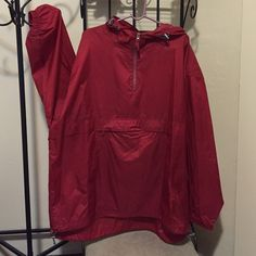 Red Foot Locker Hoodie w/Velcro Pouch. Red Foot Locker Hoodie w/Velcro Pouch.  Back has Mesh Netting. Hem has Adjustable Gray Bungee on Left & Right. PLEASE NOTE: 1/2 of the Right Side Plastic Bungee on Hem is broken but barely noticeable (as shown in 2nd picture) Foot Locker Jackets & Coats