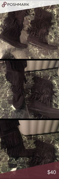 Black fringe boots These fabulous black fringe boots come to the mid calf. No zippers they are slip on boots. No signs of wear. Used twice !!!Hopefully this item can find a new fabulous home !Love it but to pricy? Would love for you to make an offer. Xx Minnetonka Shoes Ankle Boots & Booties