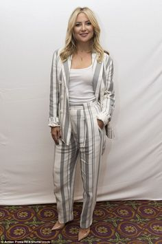 Seeing stripes: Kate Hudson cut a chic figure as she stepped out in a pantsuit for the Deepwater Horizon photocall during the Toronto International Film Festival in Canada on Monday
