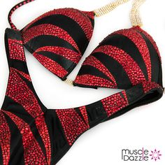 A subtle blend of orange and red crystals in dramatic stripes on black fabric. Affordable but classy figure suit design. Custom made. And don't forget to check out our full range of figure suits & competition bikinis at >> www.muscledazzle.com