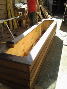 Custom Built Planter Box with a 3/4 inch  heavy duty IPE hardwood, stainless steel screws delivered to a NYCsidewalk planter box. Newyorkplantings garden designers and landscape contractors NYC builder of decks, pergolas, custom built planters planter boxes, privacy fences, pergolas, arbors hardscape. Asian garden design and landscape creations.  NY Plantings is outdoors all day, every day in the NYC landscape or garden planting scene.      Drip irrigation systems, landscape lighting