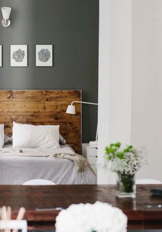 raw wood and white bed linens, mid-century #modern #loft