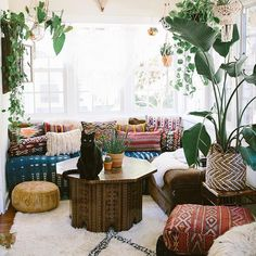 Love this- could recover rocking chair with Shibori fabric plus sheepskin, then add fun colorful decorative pillows to the couch. There is a cool shibori throw pillow seat online too or I could get an eclectic looking one. Change rug to jute or beige with cow hide.