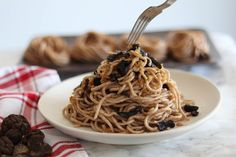 Black Truffle Pasta: -Wash and soak truffle for 6 hours (save truffle water). -Cook spaghetti in boiling water until al dente. Drain pasta. Add olive oil to skillet over medium-high heat.  -Cook garlic until golden, 2 minutes, then add truffle + truffle water and cook for another 4 minutes. -Add drained spaghetti to skillet and mix well. -Add salt and pepper to taste. Shave remaining truffle over the top.