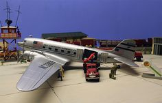 Erik Block built this DC-3 in Pan American Airways Systems paint from an Italeri Dakota DC-3 kit. Two soldiers are waiting to board their fl...