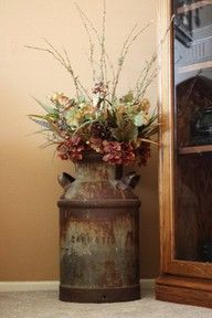 milk can with floral arrangement