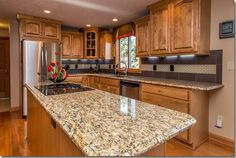 Kitchen Remodeling Countertops Giallo ornamental granite countertops with oak cabinets - Giallo Ornamental, aka Giallo Santo or Amarello Ornamental. Giallo Ornamental granite countertops blends well with a variety of cabinet and wall colors. Honey Oak Cabinets, Oak Kitchen Cabinets, Kitchen Countertop Materials, Granite Kitchen, Kitchen Flooring, Kitchen Countertops, New Kitchen, Kitchen Decor, Condo Kitchen